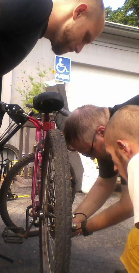guys-repairing-bike