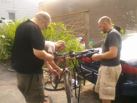three-guys-repairing-bikes