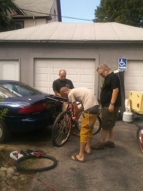 three-guys-still-repairing-bikes