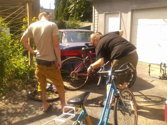 two-guys-repairing-bike